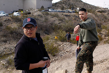 Joe Castellon from Texas State University in San Marcos, left, takes land navigation tips from 2nd Lt. Jose Valle, a reserve support officer with Marine Corp Recruiting Command, in the arroyo next to Union Building East on Feb. 6 as part of the MAES Leadership Academy that involved more than 50 students from 20 institutions, including UTEP. Photo by Ivan Pierre Aguirre / UTEP News Service