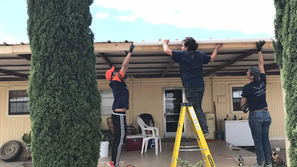 Student volunteers from The University of Texas at El Paso help install a rainwater harvesting system at a home in the Las Pampas colonia near Presidio, Texas, in this June 2017 photo.