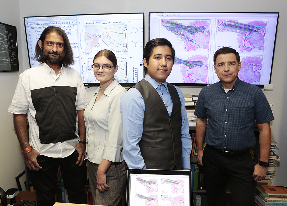 A team of UTEP professors and students has published valuable findings in creating a data migration method to utilize mapped data between different brain atlases. They are, from left, Arshad Khan, Ph.D., associate professor of Biological Sciences; Claire E. Wells, a December 2017 graduate of UTEP's Pathobiology doctoral program; Jose G. Perez, a computer science student who received his bachelor's degree in May 2018; and Olac Fuentes, Ph.D., associate professor of Computer Science. The results of the group's five-year effort were published in May 2018 in Frontiers in Systems Neuroscience, a widely read, peer-reviewed and open-access scientific journal.