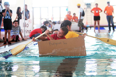 The cardboard canoe competition, a highlight of UTEP's 2014 ExciTES Summer Institute in the College of Engineering, is one of several inquiry-based, team-oriented projects that introduces middle and high school students to different engineering fields. The race takes place in UTEP's Student Recreation Center.