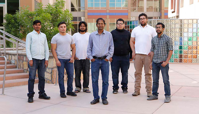 Vinod Kumar, Ph.D., associate professor in the Department of Mechanical Engineering, and his student research team stand outside the College of Engineering for a group photo in the courtyard.