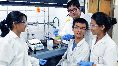 International students discuss their study of fullerenes. The chemistry students are, from left, Sandra Atehortua Bueno, from Colombia; Fernando Garcia Escobar, Mexico; Zhili Guo, China; and Andrea Cabrera, Colombia.