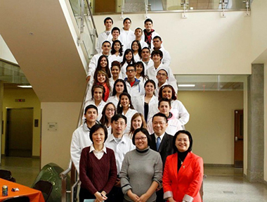 Work With a Scientist Program Director Pei-Ling Hsu, Ph.D. (front, far right) with participating scientists (from left to right, first two rows) Wen-Yee Lee, Ph.D.; Lixin Jin, Ph.D.; Chuan Xio, Ph.D.; and Bill Tseng, Ph.D., stand in front of the Irvin High School students selected to participate in the program's first year.