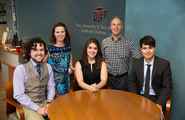 UTEP students, seated from left, Jorge Martinez, Daniela Noriega and Zach Jackson are the first B.S./MBA participants to earn their graduate degrees.