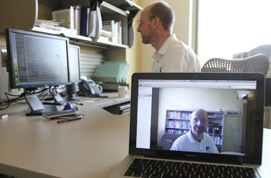 Nigel Ward, Ph.D., professor of computer science, video chats on his computer. The computer scientist is developing an idea to improve user experience and reduce bandwidth consumption when using mobile video chat. Photo by J.R. Hernandez / UTEP News Service